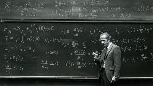 Gary Becker working at a chalkboard